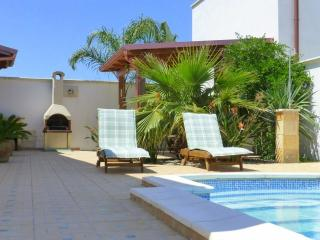 Lay back and relax in the warm sunshine beside the pool