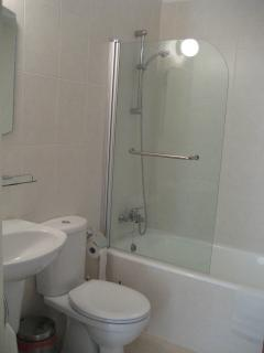 Bathroom with bath/shower combined, w.c. and hand basin