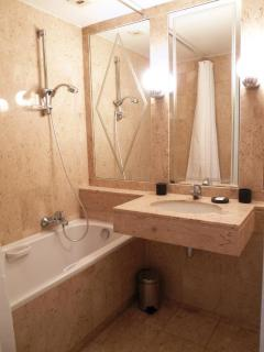 Second ensuite bathroom also with marble bath and sink top