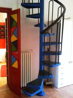 Winding staircase to the 2nd bedroom