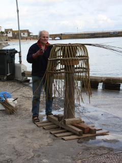 Making lobster baskets on the harbour.