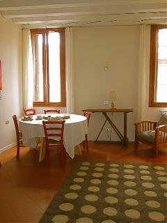 Living and dining area, nice big round table for meals or working