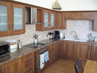 Large fitted kitchen with all new appliances.