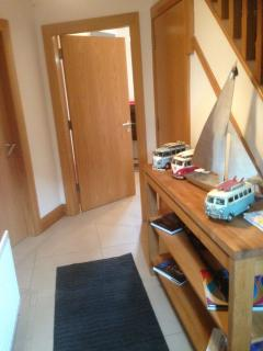 GF hallway with storage with fishing equip, set of callaway clubs, surf equip, tennis & cricket