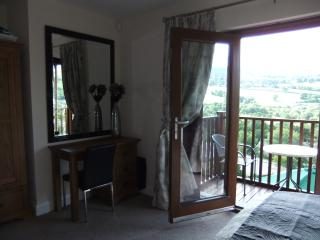 The stunning master bedroom with its own balcony and stunning veiws
