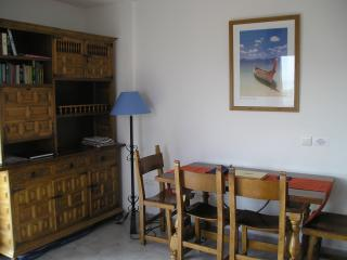 Lounge and Dining area leading on to the balcony with views over the sea, pool, mountains and Park,
