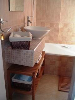 Bathroom with bath, shower, toilet and hand basin