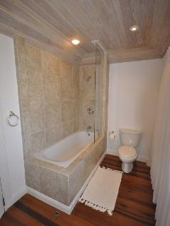 Upstairs En Suite bathroom with English style Bath and shower above