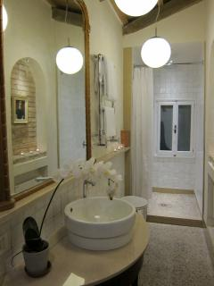 Marble from Burano, a large walk-in shower with Grohe fittings and an unearthed original window!