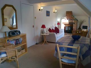 The relaxing living area with views over the cottage courtyards and Port Isaac valley.