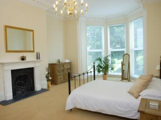 Bedroom one with sea and parkland views