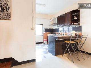 The L-shaped granite counter top also serves as a small bar for a quick breakfast or lunch.