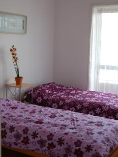 Bedroom 2 with triple fitted wardrobes, blackout shutters and sea views