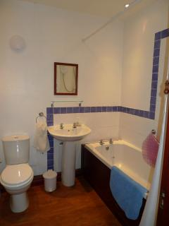 Bathroom, with electric shower over bath