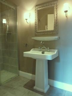 The bathroom is brand new but the washstand is the old hotel's original circa 1947