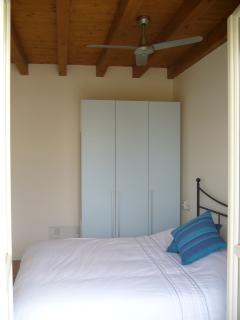 Light and airy double bedroom leading to balcony