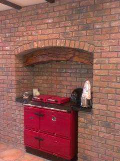 Traditional stove, oil fired, and central heating provided.