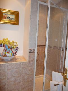 Shower and Bathroom beautifully decorated in marble