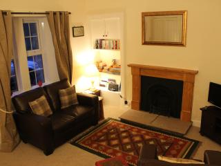 Cosy sitting room with beautiful open fire