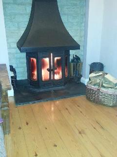 Cosy wood burning stove in the lounge