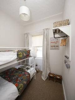Bunk beds, chest of drawers and hanging space. Toys, board games and books too