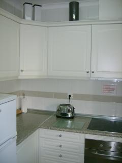 Part of kitchen, fully equipped.