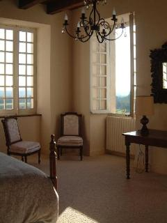 The master bedroom has a wonderful double aspect and view over the park and the hills opposite
