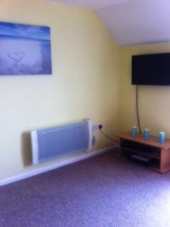 The bright and sunny lounge with wifi and freeview included, will you venture out???