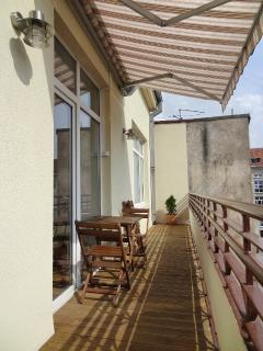 Private balcony with sunshade, outdoor furniture and outdoor lighting for the cosy evenings
