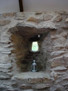 Stone niches and the tiniest window