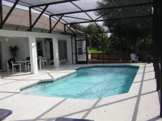 Full length view of the pool with nearby shaded area