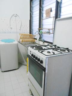 Kitchen with stove and washing machine