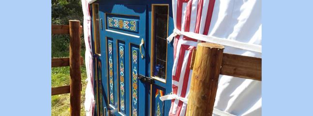 The hand painted front door of the yurt