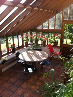 The conservatory/breakfast room available for use by guests.
