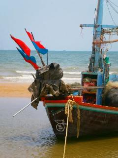 Fishing boats add local color- this one was moored right in front of Sunrise Villa!