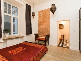 Master bedroom with queen size bed and en-suite bathroom