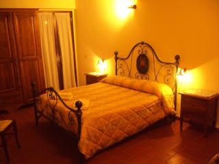 Larger of the 2 double bedrooms of Maurilio where 1 or 2 single beds can be added. Own patio area