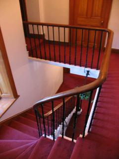 The staircase is an attractive feature of the house and dates back to the 1800's.