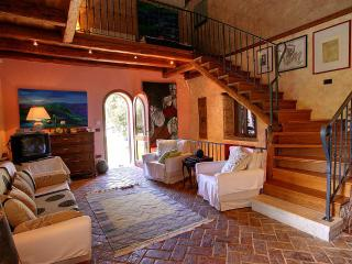 Downstairs, the scene is set by terracotta brick flooring, stone walls and original wooden beams
