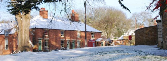 Mouse Cottage and the village green in winter
