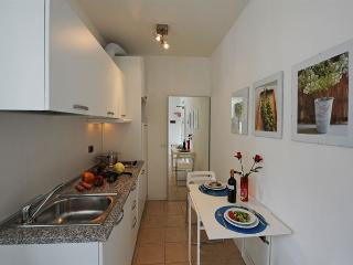 A modern kitchenette with a breakfast table for 2