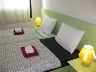 Two single beds with coconut mattress, cotton linens