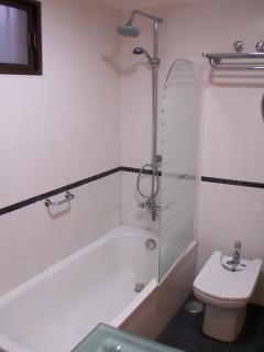 Modern 4 piece bathroom with shower and bath.