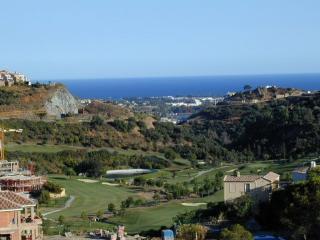 view of the golf course and sea from the lounge