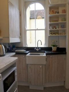 Kitchen with slate draining board and butler's sink.