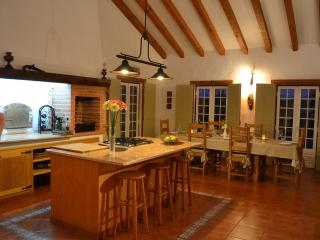The kitchen is huge with large dining area perfect place to all congregate for drinks and dinner