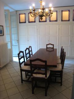 Dining Room with vast cupboards complete with crockery, glassware, cutlery, and kitchen utensils
