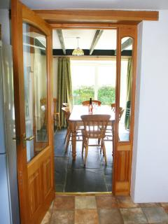 View looking through kitchen door to dining area