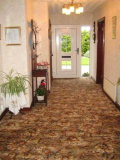 Bright extensive entrance hall leading to all rooms.