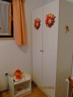 The wardrobe in the main bedroom